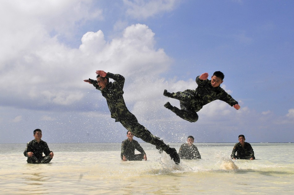Chinese soldiers exercise during a training session at a beach on the Xisha islands
