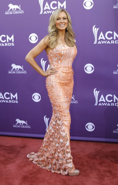 Singer Jewel poses as she arrives at the 48th ACM Awards in Las Vegas, April 7, 2013.