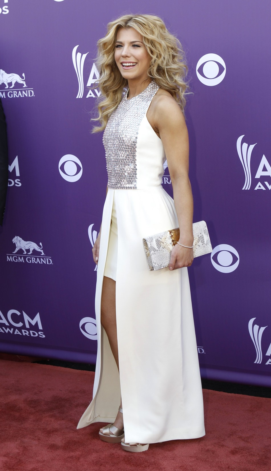 Kimberly Perry from The Band Perry arrives at the 48th ACM Awards in Las Vegas, April 7, 2013.