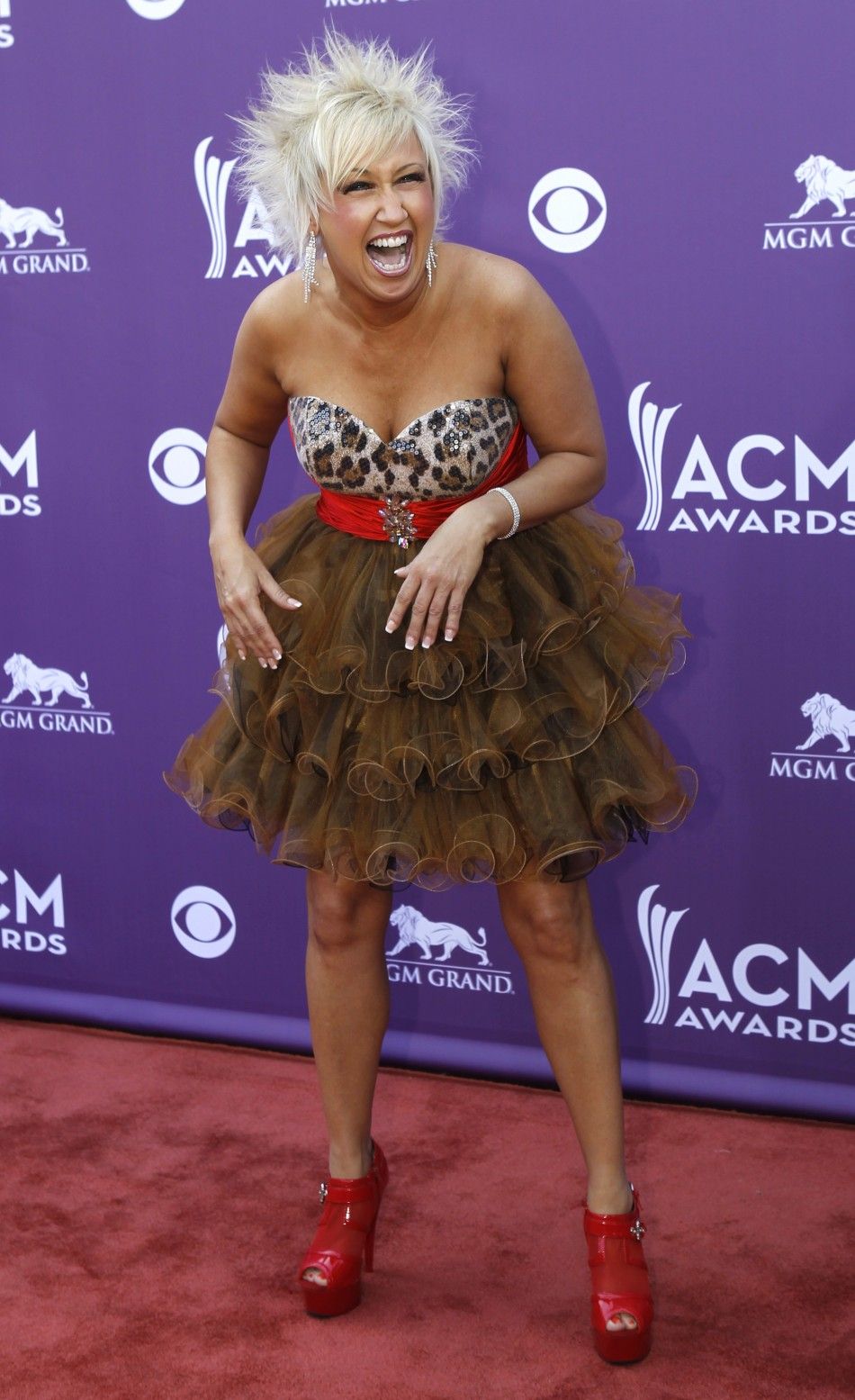Tobi Lee of Mustang Sally arrives at the 48th ACM Awards in Las Vegas, April 7, 2013.