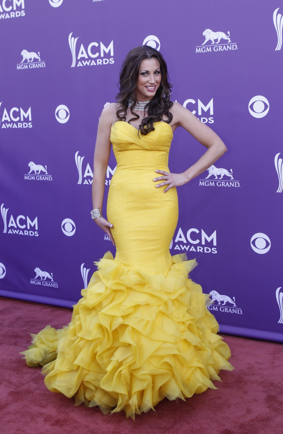 Singer Danielle Peck poses as she arrives at the 48th ACM Awards in Las Vegas, April 7, 2013.