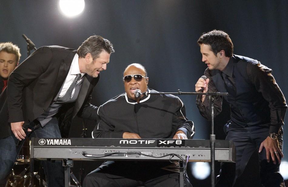Hosts Blake Shelton L and Luke Bryan perfom Signed Sealed Delivered with Stevie Wonder C at the 48th ACM Awards in Las Vegas, April 7, 2013.