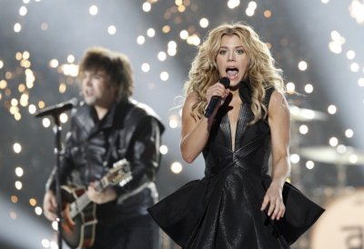 Kimberly Perry, of The Band Perry, performs Done during the 48th ACM Awards in Las Vegas April 7, 2013.