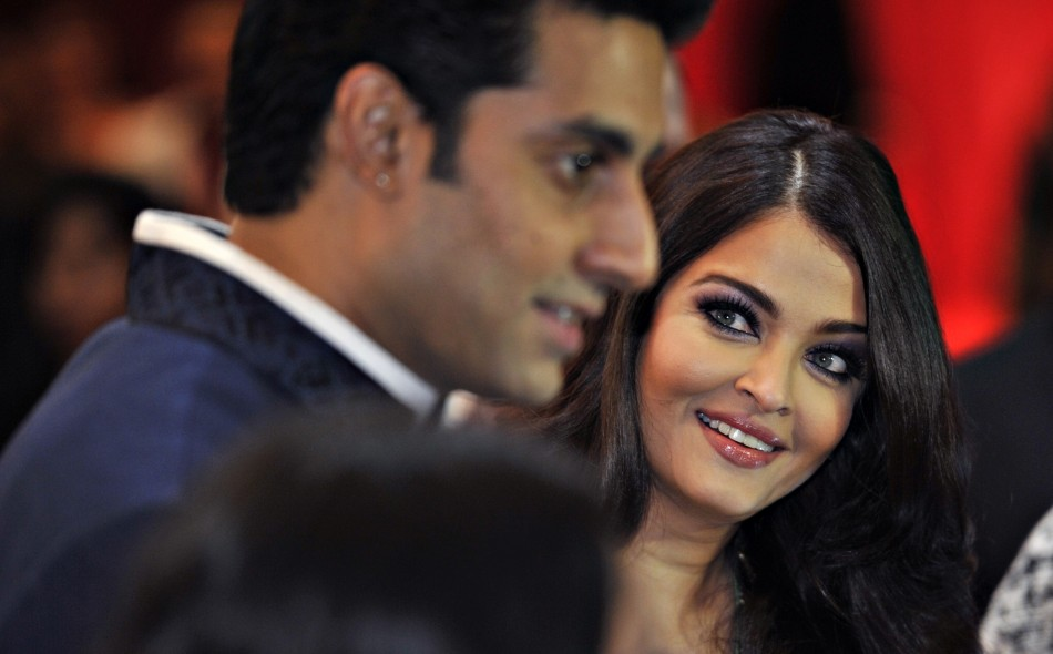 Actor Abhishek Bachchan and wife actress Aishwarya Rai arrive for the inaugural Times of India Film Awards in Vancouver, British Columbia April 6, 2013.