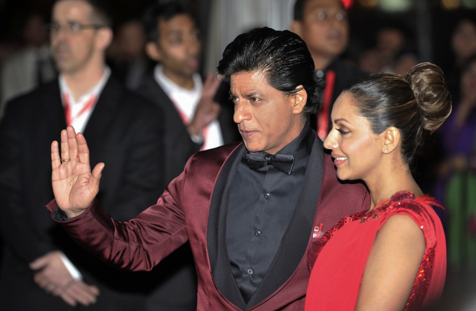 Actor Shah Rukh Khan and his wife Gauri Khan arrive for the inaugural Times of India Film Awards in Vancouver, British Columbia April 6, 2013.
