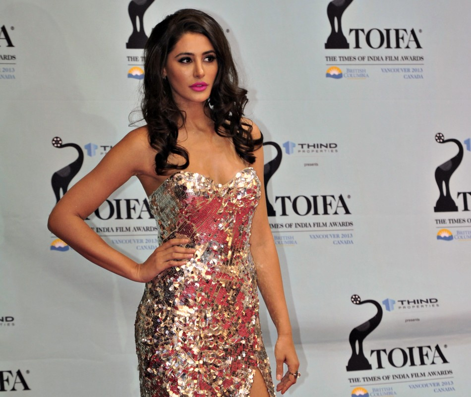Model Nargis Fakhri of the U.S. arrives for the inaugural Times of India Film Awards in Vancouver, British Columbia April 6, 2013.