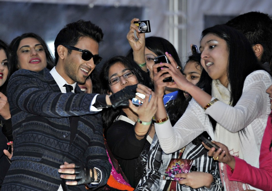 Singer Abbas Hasan of Canada greets fans as he arrives for the inaugural Times of India Film Awards in Vancouver, British Columbia April 6, 2013
