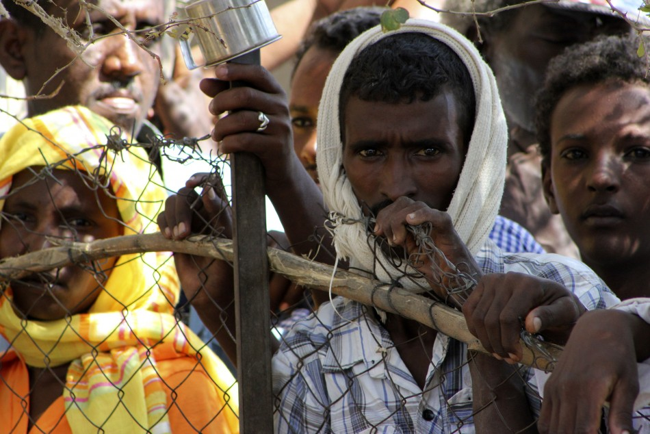 Refugees are seen during a visit by UN High Commissioner for Refugees Antonio Guterres to the Shagarab Eritrean Refugees camp