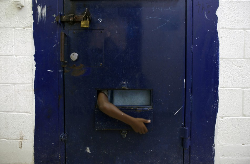 A young refugee from Eritrea reaches his arm out of his cell at Givon Prison in Ramle near Tel Aviv