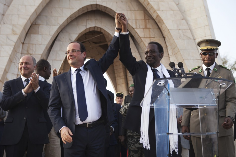 Victory: President Hollande with Mali's interim president Dioncounda Traore