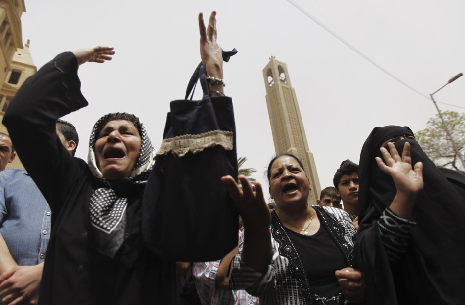 Coptic Christian (L and C) and Muslim (R) women shout slogans against Egyptian President Mohamed Mursi