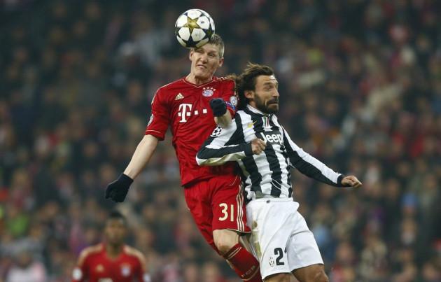 Bastian Schweinsteiger (L) and Andrea Pirlo