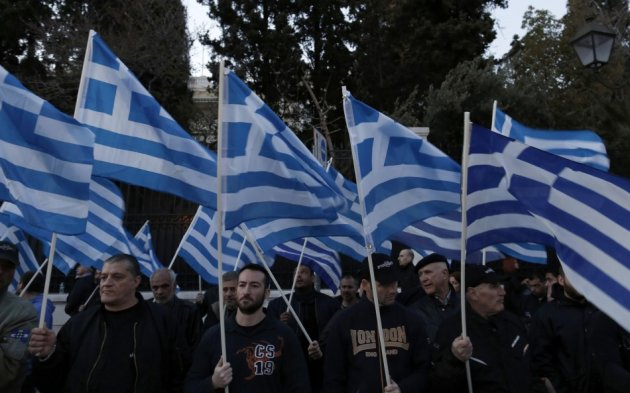 Supporters of the extreme-right Golden Dawn party hold Greek flags, during a rally over the crisis in Cyprus