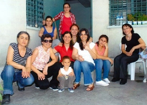 Meral Kurum (in red) sits behind her son, Renas, alongside  political prisoners in Bakirkoy Woman's Prison (Zeynep Kuray)