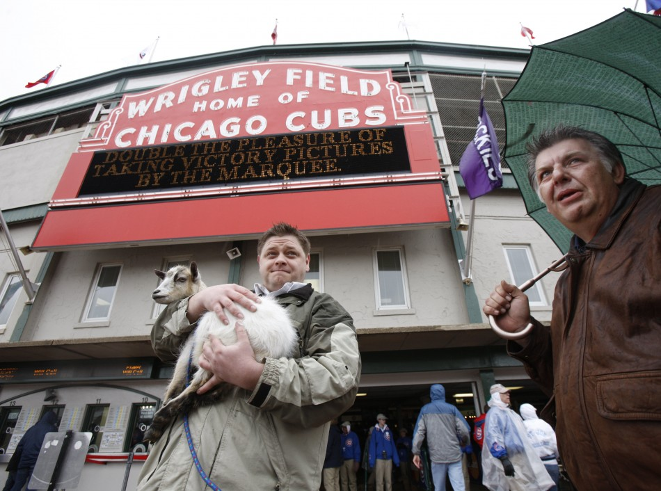 Chicago Cubs fans Charlie Thomas (L) and Eddie Weingartner stand outside Wrigley Field