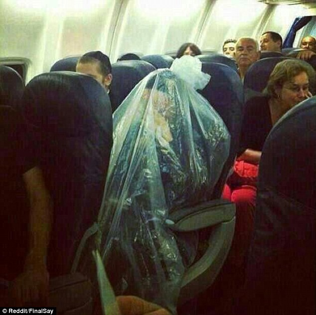 Passenger wraps himself in plastic bag.