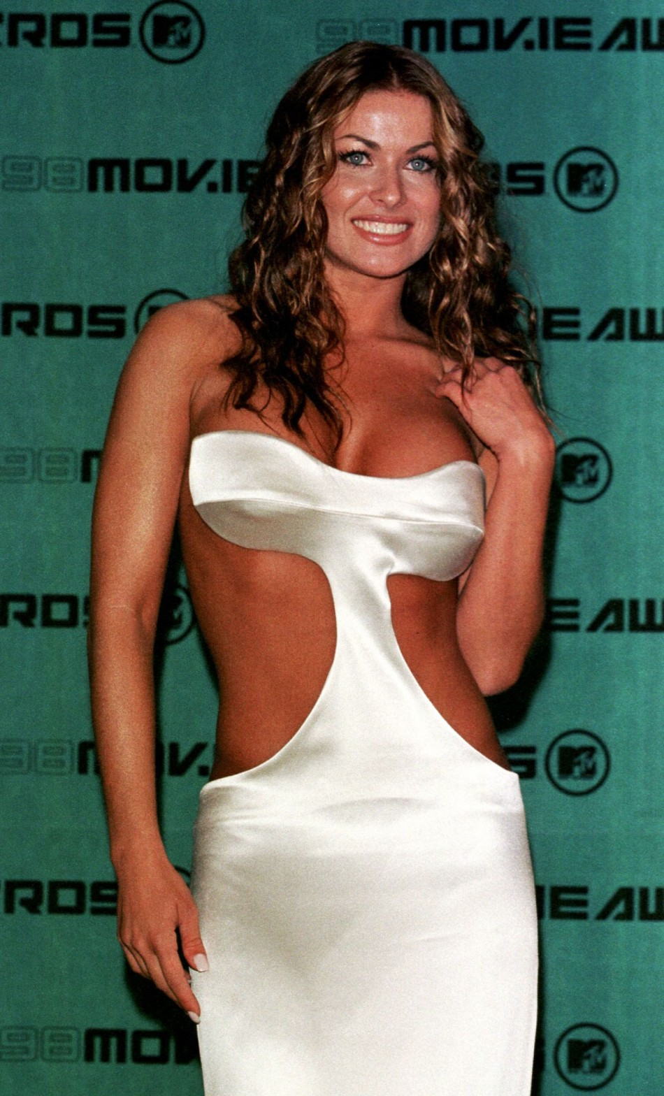 Television personality Carmen Electra poses for photographers at the 1998 MTV Movie Awards which were taped May 30 in Santa Monica. Electra co-hosts