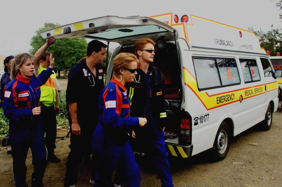 Medics help the victim of a South African road accident.