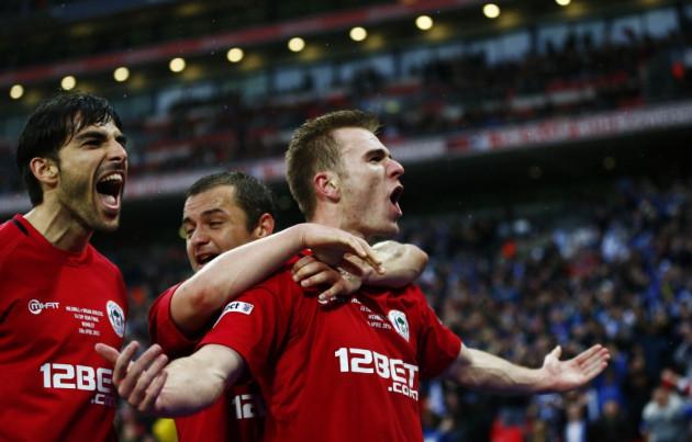Wigan Athletic's Callum McManaman celebrate's sinking Millwall