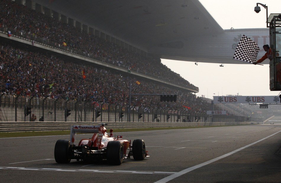 Fernando Alonso takes the chequered flag to win the Chinese Grand Prix