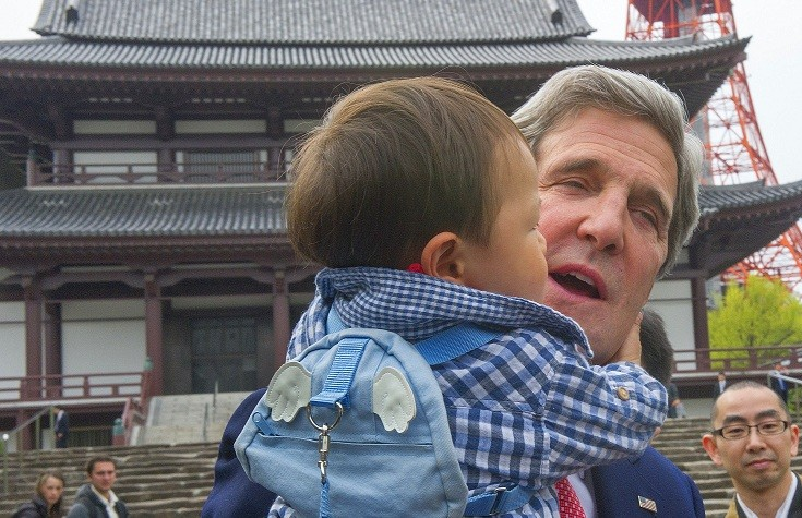 Kerry cuddles baby in Tokyo during mission to Asia