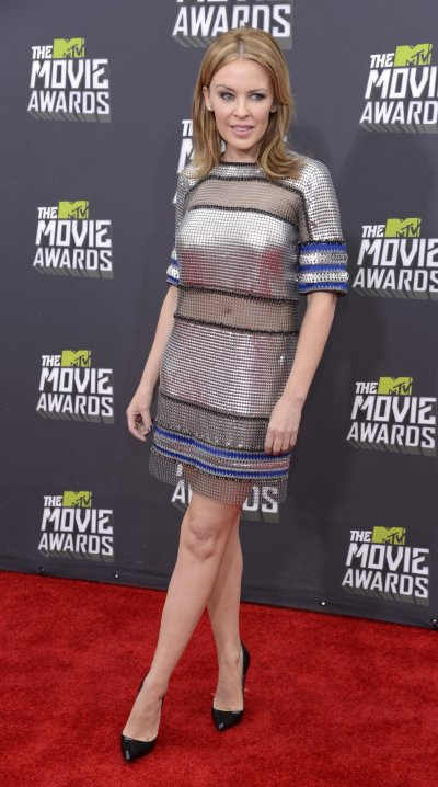 Singer Kylie Minogue arrives at the 2013 MTV Movie Awards in Culver City, California April 14, 2013.