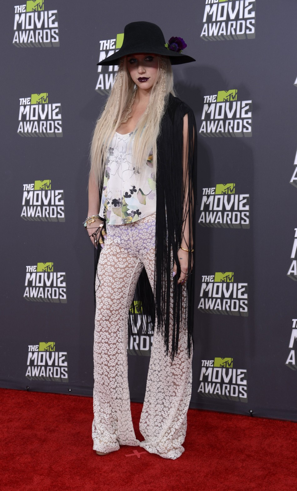 Singer Keha arrives at the 2013 MTV Movie Awards in Culver City, California April 14, 2013.