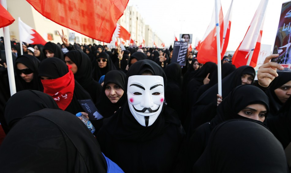 A female protester wearing a Guy Fawkes mask participates in an anti-government rally organised by Bahrain's main opposition group Al Wefaq