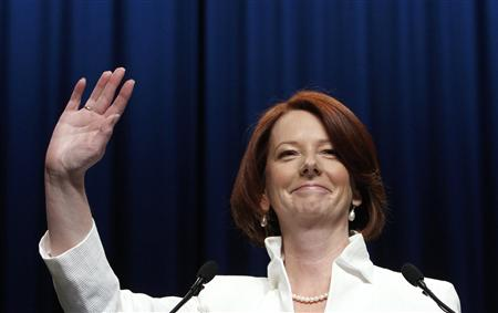 Australian Prime Minister Julia Gillard waves to supporters at the Labor Party election headquarters in Melbourne