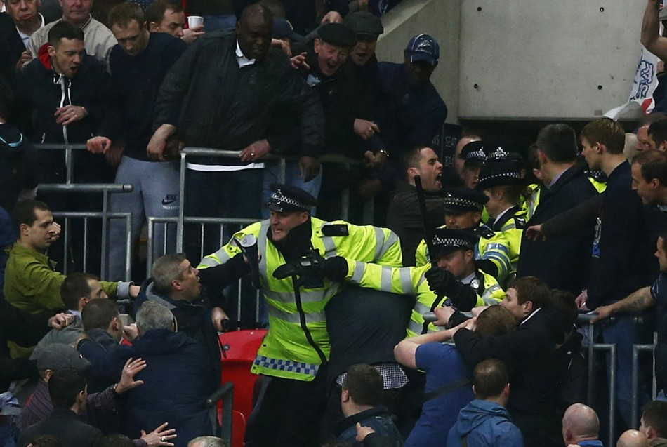 Millwall fans clash with police at Wembley