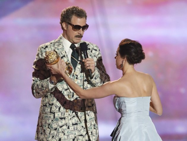 Actor Will Ferrell accepts the comedic genius award and actress Aubrey Plaza tries to prise it away at the 2013 MTV Movie Awards in Culver City, California April 14, 2013.