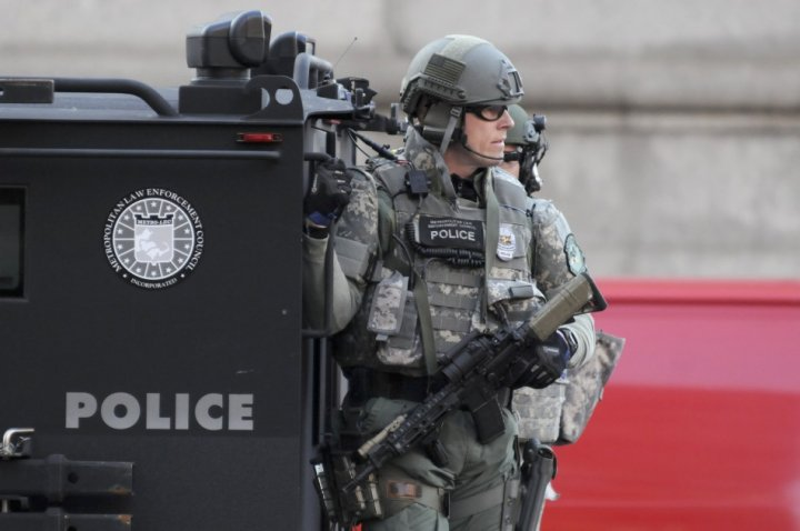 SWAT officers patrol the Copley Square area after explosions near the finish line of the Boston Marathon in Boston,
