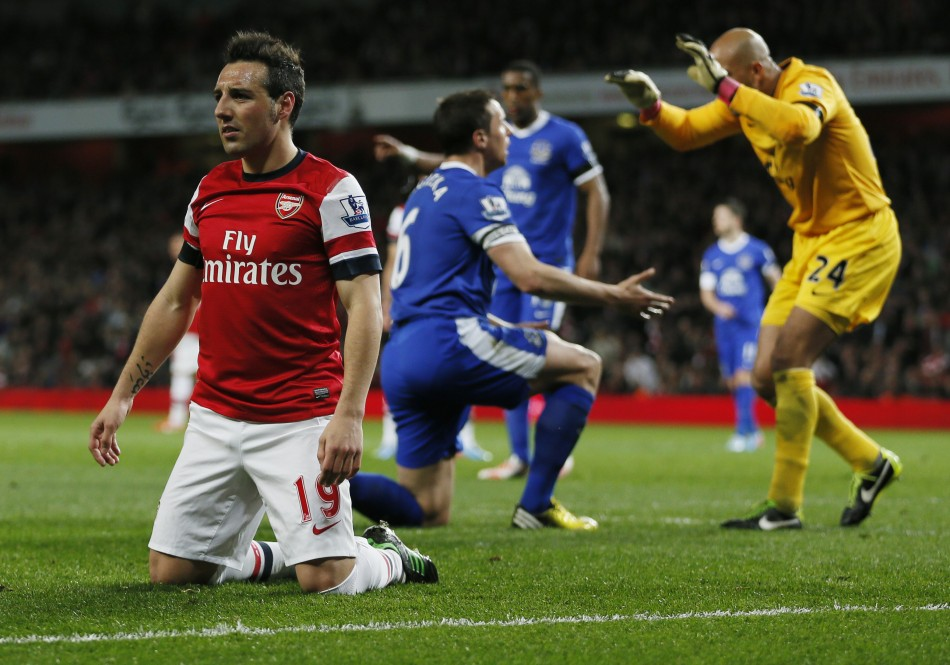 Arsenal's Santi Cazorla reacts after an unsuccessful attempt scoring attempt past Everton goal keeper Tim Howard (R) during the English Premier League match at Emirates Stadium in north London April 16, 2013