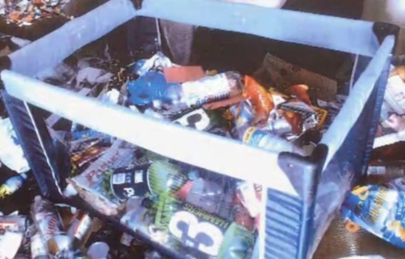 Declan Hainey's playpen where he slept was filled with empty plastic cider bottles and debris (Crown Office)