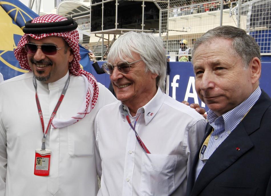 Formula One commercial supremo Bernie Ecclestone (C) poses with Crown Prince Sheikh Salman bin Hamad al-Khalifa (L) and FIA President Jean Todt before the Bahrain F1 Grand Prix