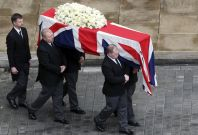 Margaret Thatcher's coffin is carried at St Paul's