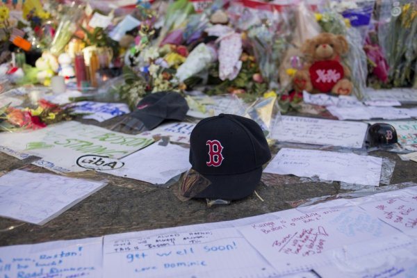 A Boston Red Sox hat is seen among a makeshift memorial for the victims of the Boston Marathon bombings on Boylston street