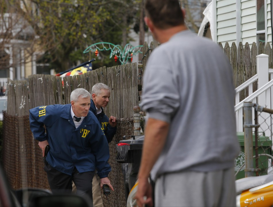 FBI agents search homes for the Boston Marathon bombing suspects in Watertown