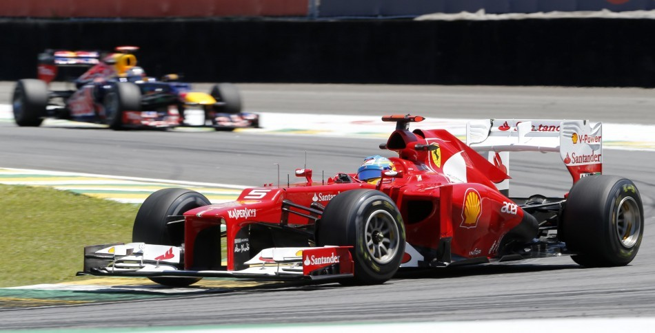 Fernando Alonso (in front) and Sebastian Vettel