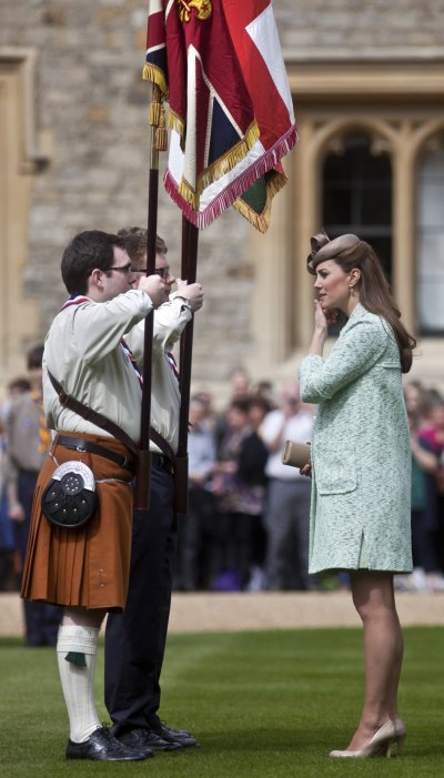 Britains Catherine, Duchess of Cambridge, showing visible signs of pregnancy, attends the National Review of Queens Scouts at Windsor Castle in Berkshire, near London April 21, 2013.