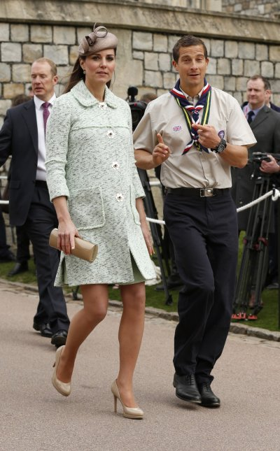 Britains Catherine, Duchess of Cambridge and Chief Scout Bear Grylls R attend the National Review of Queens Scouts at Windsor Castle in Berkshire, near London April 21, 2013.