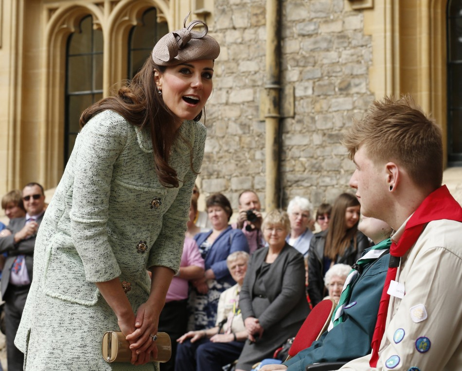 Britains Catherine, Duchess of Cambridge, showing visible signs of pregnancy, meets scouts during at the National Review of Queens Scouts at Windsor Castle in Berkshire, near London April 21, 2013.