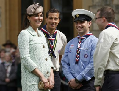 Britains Catherine, Duchess of Cambridge, showing visible signs of pregnancy, meets Chief Scout Bear Grylls 2nd L and Sea Scout Rob Butcher 2nd R while attending the National Review of Queens Scouts at Windsor Castle in Berkshire, near Lon