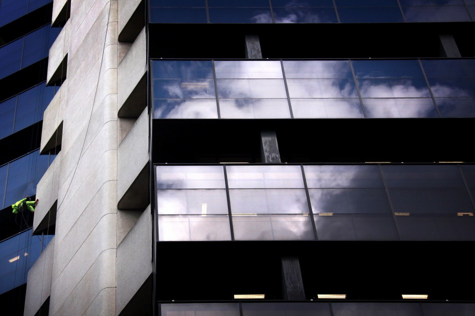Clouds are reflected in the windows of a building in Sidney