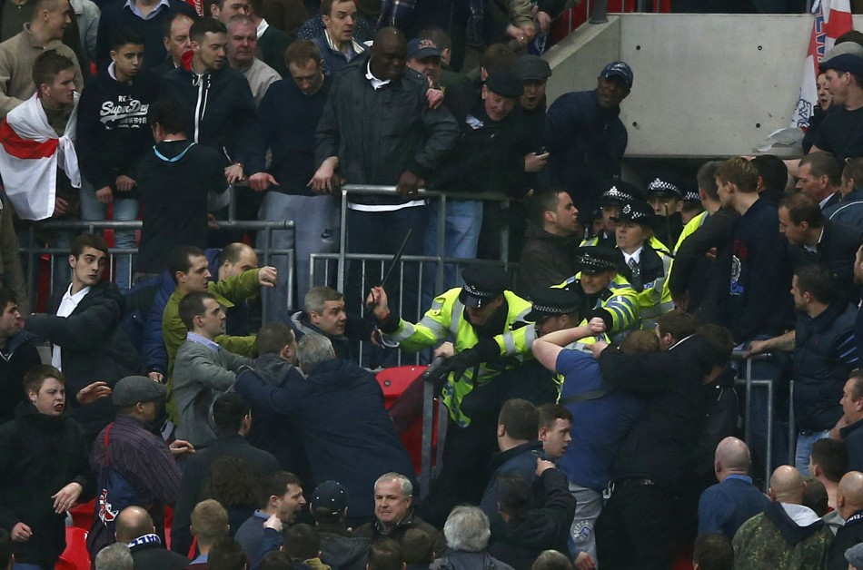 Millwall fans fight with police officers during their FA Cup semi-final game against Wigan Athletic at Wembley Stadium (Reuters)