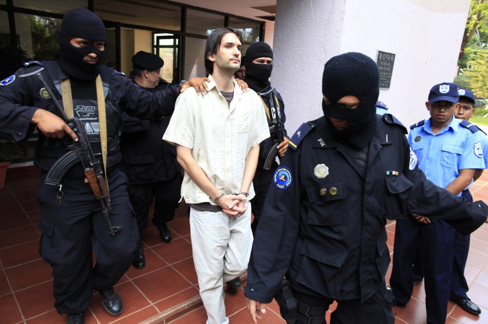 Eric Justin Toth is escorted after a presentation to the media at police headquarters building in Managua (Reuters)
