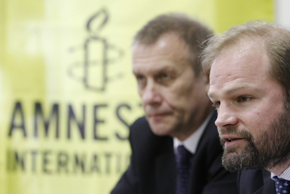 John Dalhuisen (R), Deputy Director for Europe and Central Asia at Amnesty International,