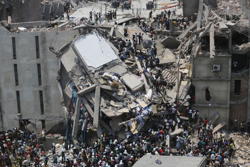 People rescue garment workers trapped under rubble at the Rana Plaza building after it collapsed