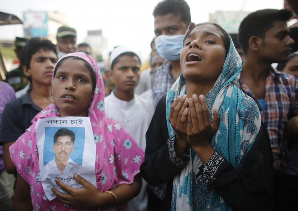 Relatives wait for news of their relatives missing after the Dhaka factory collapse.