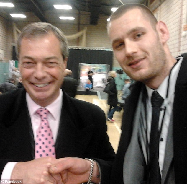 Ukip leader Nigel Farage (left), shaking hands with Chris Scotton, who was suspended by the UK Independence Party for 'liking' a Facebook page which suggests racism is 'ethnic banter'. (Facebook)